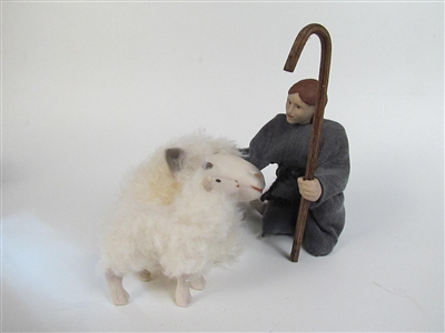 little shepherd boy with sheep