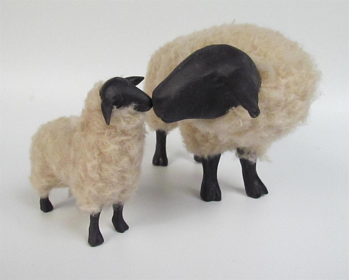 Suffolk Ewe Snuggling A Lamb