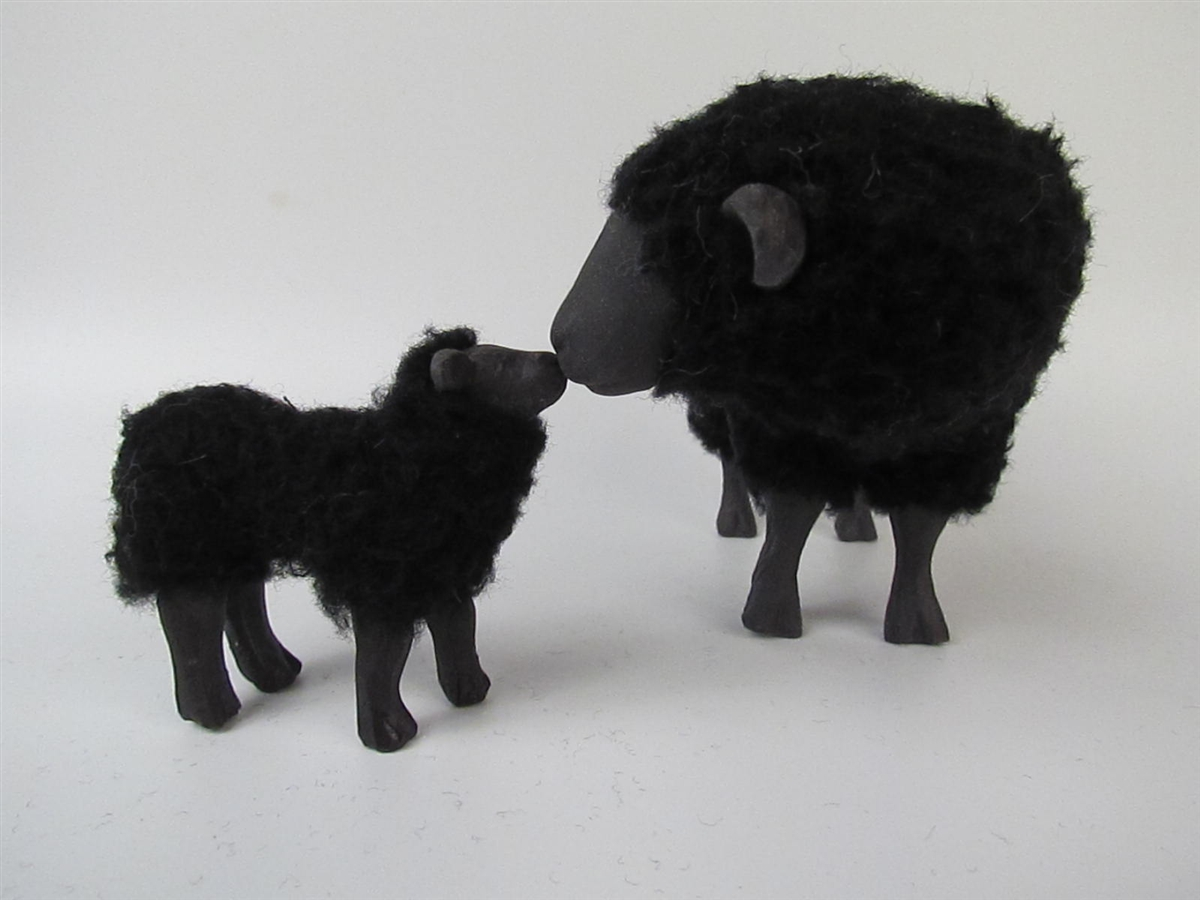 Black Sheep Ewe Nos to Nose With Little Lamb